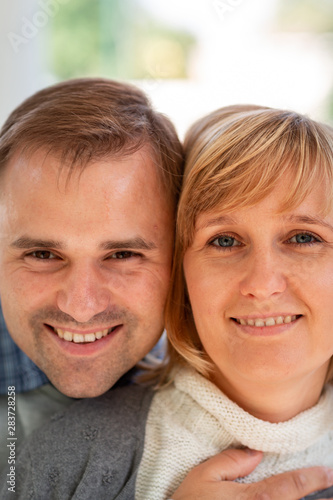 Happy young couple hugging and laughing together in the park #283728258