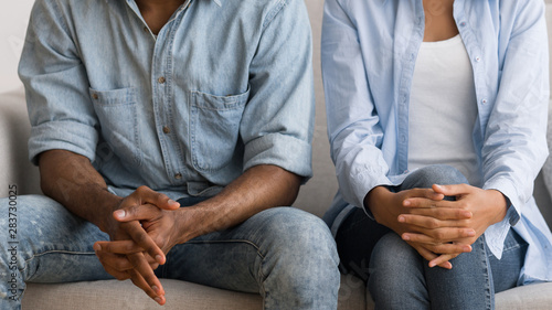Unrecognizable Afro Couple Sitting On Couch At Marital Counselor's Office Canvas Print