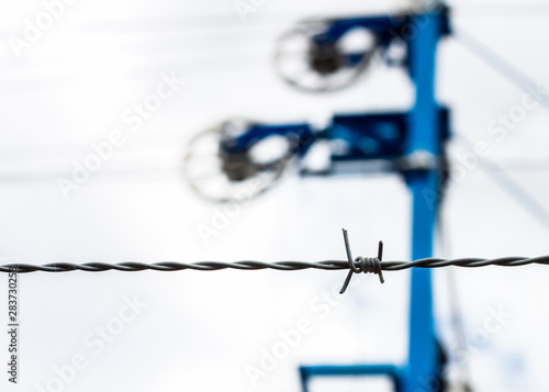 A barbed wire with railroad mechanism in the back Canvas Print