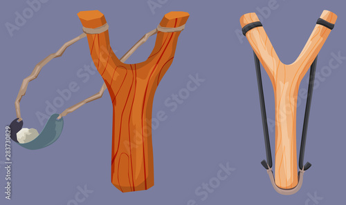 Vászonkép Wooden slingshot with stone bullet