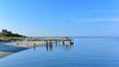 Raised wooden dock along a beach