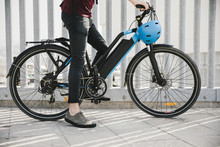 Urban Cyclist Taking A Brake On E-bike