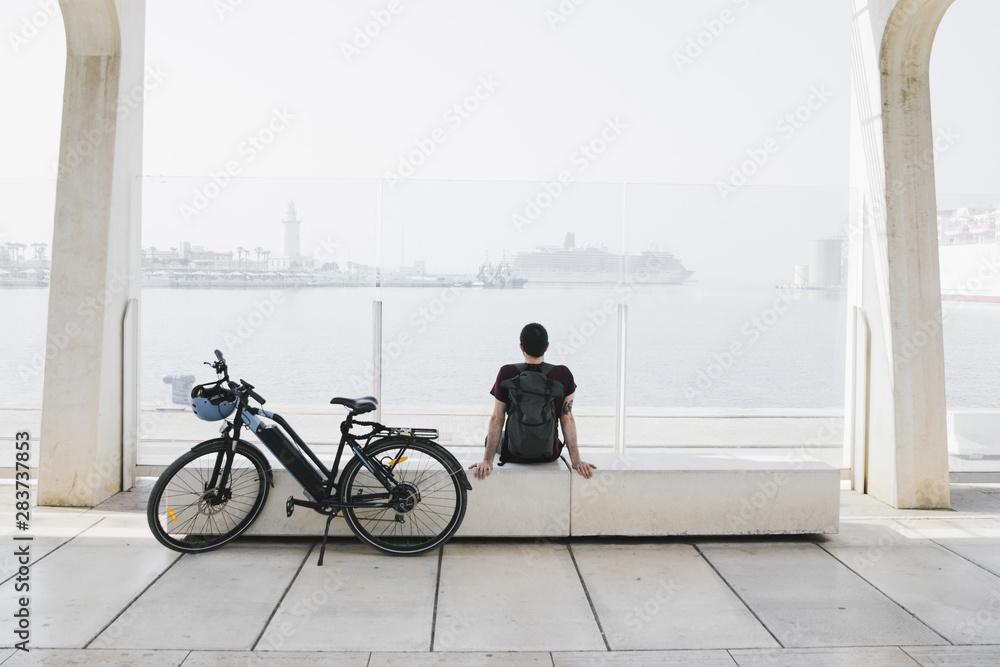 Fototapety, obrazy: Long shot e-bike next to relaxin man on bench