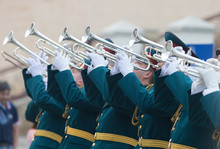A Wind Instrument Parade - Men In Green Official Costumes Playing Trumpets
