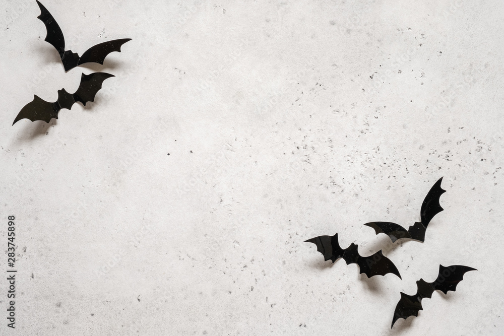 Obraz halloween decoration concept - black bats on white concrete background fototapeta, plakat