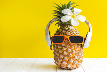 Summer In The Party.  Hipster Pineapple Fashion In Sunglass And Music Bright Beautiful Color In Holiday, Creative Art Fruit For Tropical Style On The Beach Vibes, Yellwo Background.  Fashion Summer