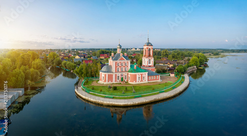 Red church on side of Pleshcheevo lake in Pereslavl-Zalessky Wallpaper Mural