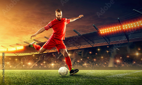 soccer-player-in-action-with-a-ball-on-a-stadium