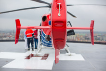 Modern Medical Helicopter On A Hospital Rooftop Helipad From Behind - Shallow DOF