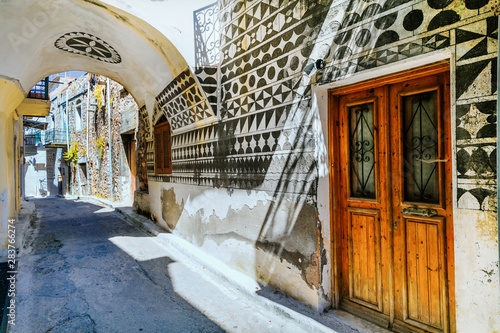 Old streets of beautiful unique village Pyrgi on Chios island. Landmarks of Greece.