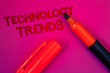canvas print picture - Conceptual hand writing showing Technology Trends. Business photo text Trending Modern Viral Advanced Development Trendy New Magenta color platform dark red color tidings corner red marker