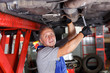 Mechanician repairing car