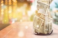 Glass Jar For Money  On Backgr...