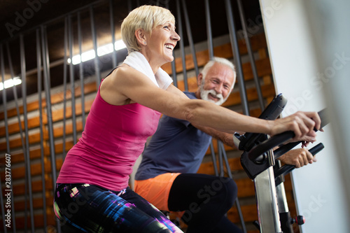 obraz PCV Mature fit couple exercising in gym to stay healthy