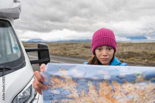 Fototapeta Lost tourist on Iceland road trip looking for directions on travel map driving motorhome campervan on Europe adventure vacation