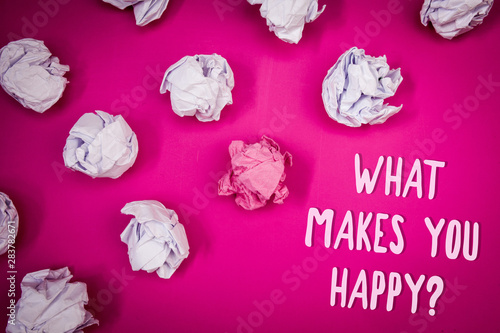 Spoed Fotobehang Roze Conceptual hand writing showing What Makes You Happy Question. Business photo text Happiness comes with love and positive life Ideas pink background crumpled papers trial mistakes several tries
