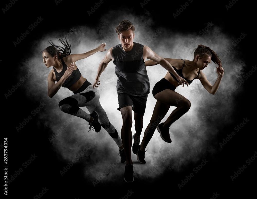 Fototapeta Running collage. Man and women running on smoke background