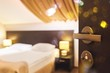 Open wooden door to the bedroom with a double bed