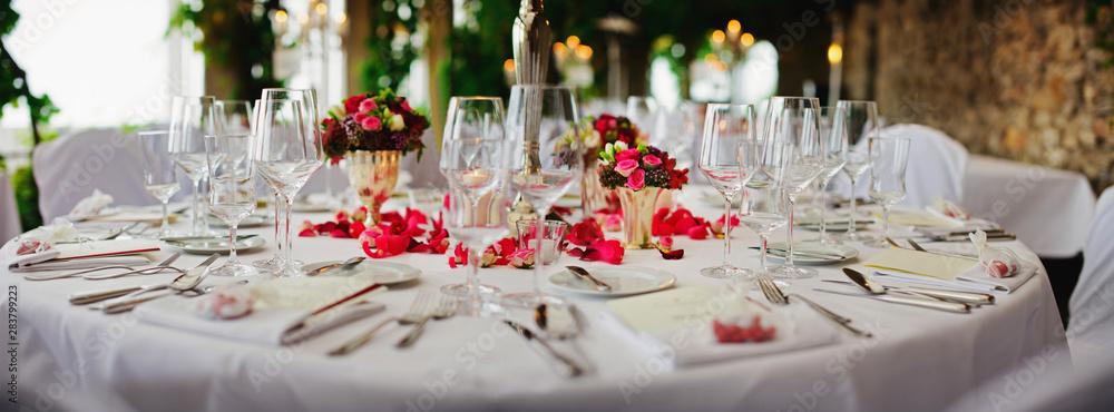 Fototapeta wedding - decorated table at luxury event