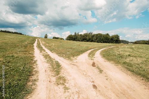 Obraz na plátně  two rural road between fields