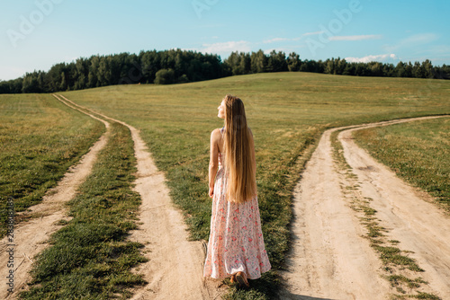 Photo woman in front of two roads thinking deciding hoping for best taking chance