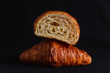 A Croissant Cut In Half On Top...
