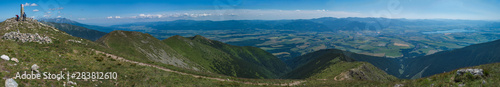 Fototapeta Panoramic view from Baranec peak on Western Tatra mountains or Rohace panorama. Sharp green mountains - ostry rohac, placlive and volovec with hiking trail on ridge. Summer blue sky white clouds. obraz
