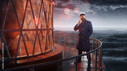 Seemann steht an Leuchtturm Tapéta, Fotótapéta