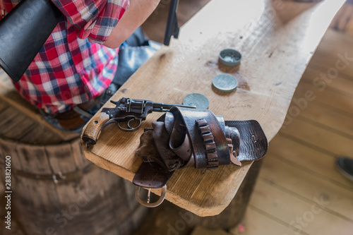 Fototapeta  Cowboy revolver holster on table