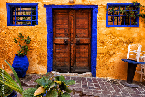 Traditional mediterranean backyard with old doors