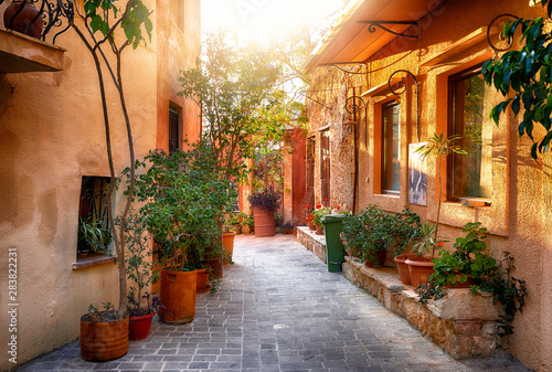 Foto Traditional mediterranean street with plenty of plants