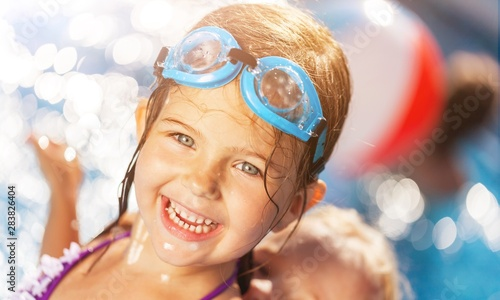 Beautiful little girl sunning at the pool Canvas Print
