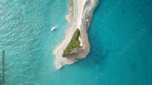 Foto auf Gartenposter Baume Aerial drone bird's eye view photo of iconic white rock volcanic tropical islet with emerald clear water sea
