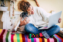Cheerful Adult Caucasian. Woman Work Happy With Tablet Computer Hugging Her Best Friend Old Funny Dog Pug - Coloured Image For Happiness Concept And Animals Love Therapy