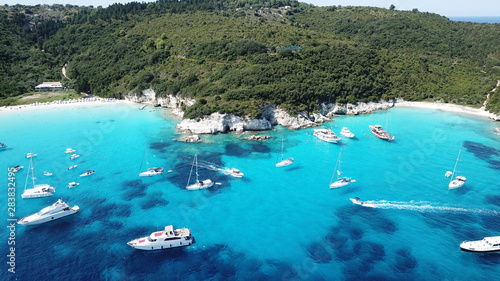 Poster de jardin Europe Méditérranéenne Aerial drone photo of tropical paradise turquoise beach of Voutoumi with sail boats docked in island of Antipaxos, Ionian, Greece