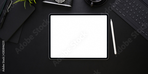 Stampa su Tela  Top view of blank screen tablet on black leather background