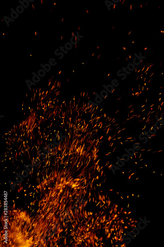 Aluminium Prints Firewood texture flame of fire with sparks on a black background