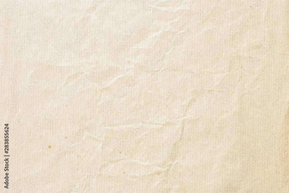 Fototapeta Old pale brown crumpled paper background texture