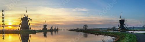 Fototapeta Rotterdam Netherlands, sunrise panorama landscape of Dutch Windmill at Kinderdijk Village obraz na płótnie