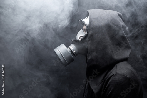 A man in a gas mask in the abstract smoke Canvas Print