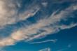 Leinwandbild Motiv white clouds on a background of blue sky on a sunny day.
