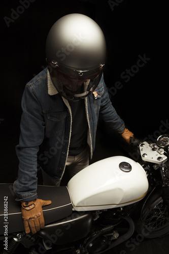 Obraz na plátne Man on cafe racer style motorbike