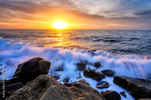 Staande foto Zee zonsondergang The stunning seascape with the colorful sky and water foam at the rocky coastline of the Black Sea