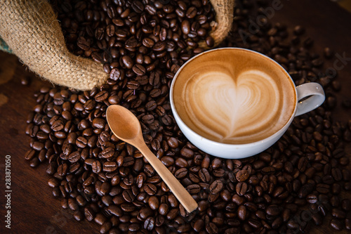 Recess Fitting Cafe coffee latte with coffee beans on dark background, top view