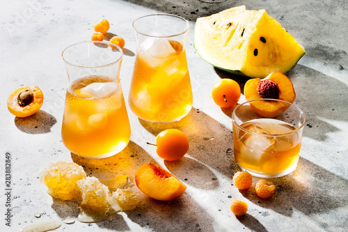 Refreshing peach ice tea or lemonade in glasses Canvas Print