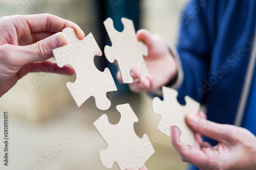 Fototapety, obrazy: Cooperation puzzle partnership teamwork business strategy.