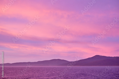 Foto auf AluDibond Rosa Lovey Sunrise seen from the cruise ship near Stewart Island (Rakiura), New Zealand
