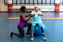 Trainer Assisting Disabled Sen...