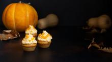Pumpkin Cupcakes On A Dark Bac...
