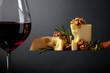 Leinwandbild Motiv  Maasdam cheese with walnuts, rosemary and red wine.